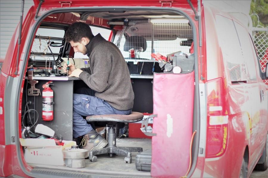 Dion Di Leva soldering in a mobile van